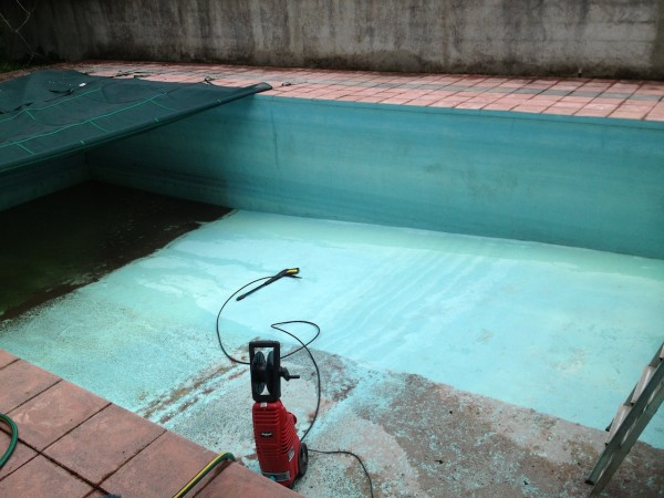 A pressure washer inside the swimming pool