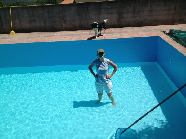 Laura standing in the swimming pool as it fills up