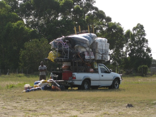 A car overloaded with furniture